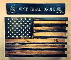 black and wood american flag home defense concealment wall