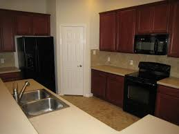 kitchen ideas with black appliances wood kitchen cabinets with black appliances kashiori com wooden