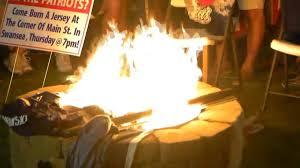 despite warnings patriots fan burns team jerseys in protest necn
