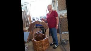 85 yr makes wooden wishing well for garden