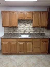stone countertops honey oak kitchen cabinets lighting flooring
