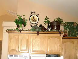 Decorate Top Of Kitchen Cabinets How To Decorate Above Kitchen Cabinets On A Budget Design Idea