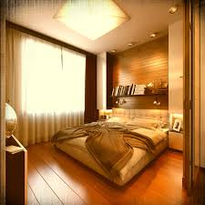 modern bedroom design with wooden flooring also large glass wall