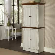 fancy double white color wooden kitchen pantry cabinets featuring