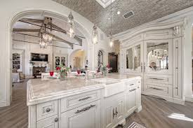 stunning french villa custom home kitchen with white interior