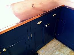 navy blue cabinets with copper counter tops dream house