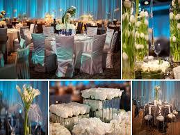 modern wedding reception decor blue lighting white flowers and
