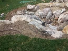 Landscape Rock Utah by Landscaping In Bountiful Utah Landscaper Installing Huge Rock