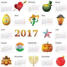 year 2017 calendar with holiday symbols stock vector art 586382042