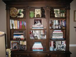 the art of arranging a bookshelf u2026 more is more mom