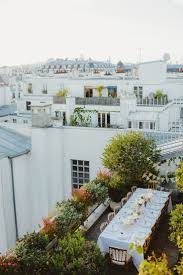 intimate rooftop dining in paris gardens and yard art