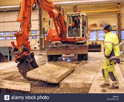 concrete floor demolition with excavator stock photo royalty free