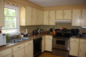 two tone kitchen cabinets brown and white image andrea outloud