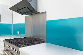 fun kitchen backsplash combining stainless steel behind the