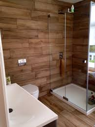 20 amazing bathrooms with wood like tile modern shower woods our bathroom at home wood effect porcelain tiles mandarin stone porcelanosa shower victoria plumb bath and toilet split face mosaic tiles behind bath