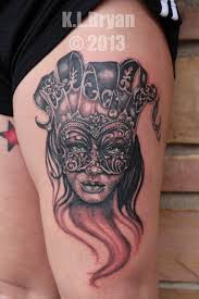 female thigh tattoos female jester in mask tattoo on thigh photos pictures and