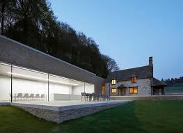 old and new minimalist modern addition to an english country home
