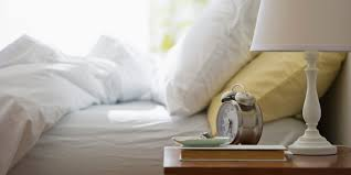 Bed With A Lot Of Pillows How To Kick Your Snooze Button Habit Huffpost