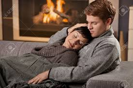 Free Hug Sofa by Young Couple Hugging On Sofa In Front Of Fireplace At Home Woman