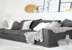 black and white sofa throws patterned throw pillows against a