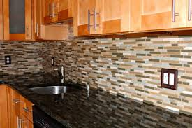 cozy mosaic kitchen tile backsplash design with wooden cabinet