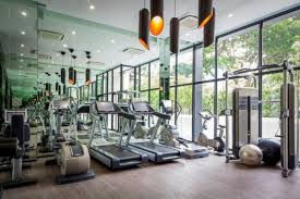 apartment modern communal gym design in spacious room with big