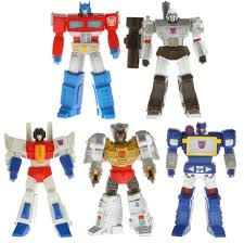 the blot says sdcc 13 exclusive transformers titan guardians