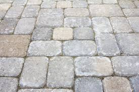 garden backyard concrete stone brick pavers patio closeup stock