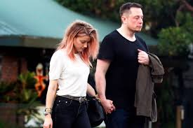 amber heard and elon musk photographed together page six