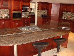 granite countertop kitchen table with cabinets blue glass flower