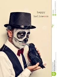 man with calaveras makeup and crow and text happy halloween stock