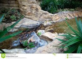 indoor garden with waterfall design stock photo image 64676608