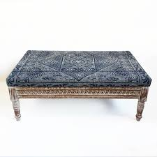 indigo dot vintage fabric covered ottoman with carved wood white