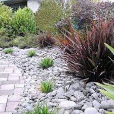 border rock garden ideas with polished pebble stones natural