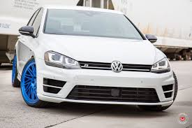 volkswagen golf custom reworked front end on white vw golf r that sits on blue custom
