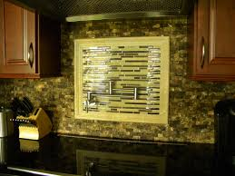 kitchen backsplash with glass tiles travertine edge with a pot
