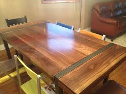 hand made black walnut dining table with welded steel base by
