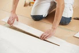 Laminate Cork Flooring Worker Carpenter Installing Or Repair Parquet Floor On Cork