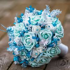 teal flowers frozen inspired teal and turquoise winter wedding bouquet real