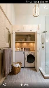hidden laundry room in a bathroom just use the washer as a dirty