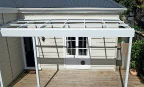 How To Build A Pergola Attached To House by How To Build A Pergola On To A House Mitre 10