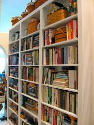 hallway library shelves both sides of door and over would have