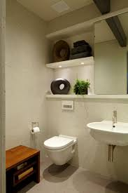 small bathroom with accessories and white wall mounted toilet