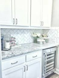 backsplash for a white kitchen white kitchen cabinets blend with calacatta gold countertop and