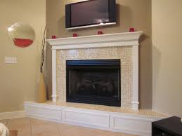 black steel fireplace with small cream tile around plus white