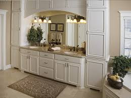 Bronze Light Fixtures Bathroom This Luxurious Master Bathroom Features Floor To Ceiling Enameled