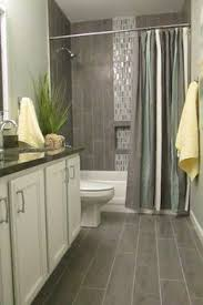 bathroom tile flooring ideas view this great contemporary bathroom with high ceiling