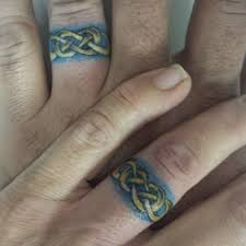 tattoos of wedding rings 78 wedding ring tattoos done to symbolize your