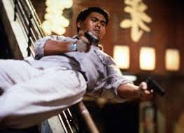 Sliding Down Banister Chow Yun Fat Sliding Down The Banister With Two Guns Blazing In