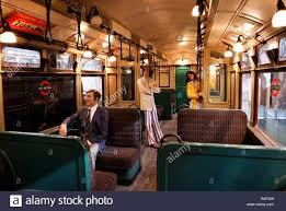 interior of an old underground train london transport museum